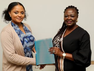 Moyeen Abiodun, Country Manager, Powergen and Adejoke Odumosu, Head PMU, REA shaking hands after the signing of documents